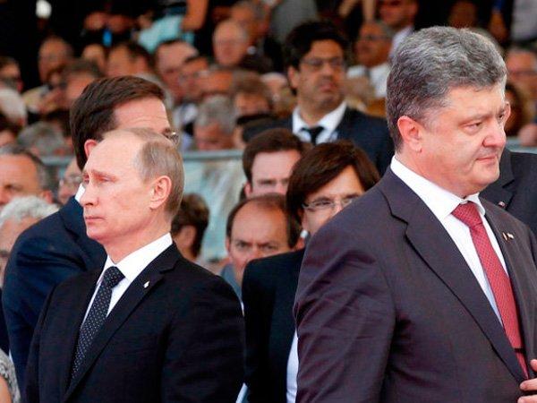 ВКремле поведали подробности разговора В. Путина иПорошенко вБерлине